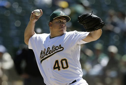 Oakland Athletics pitcher Bartolo Colon (40) delivers against the Houston Astros during the first inning of a baseball game in Oakland, Calif., Wednesday, April 17, 2013. (AP Photo/Jeff Chiu)
