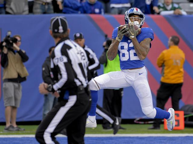 <p>New York Giants wide receiver Roger Lewis (82) catches a pass for a touchdown against the Philadelphia Eagles during the first quarter of an NFL football game, Sunday, Nov. 6, 2016, in East Rutherford, N.J. (AP Photo/Bill Kostroun) </p>