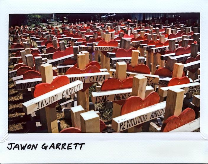 A cross for gunshot victim Jawon Garrett sits among dozens of others at a make-shift memorial for those lost to firearm violence in Chicago (AFP Photo/JIM YOUNG)