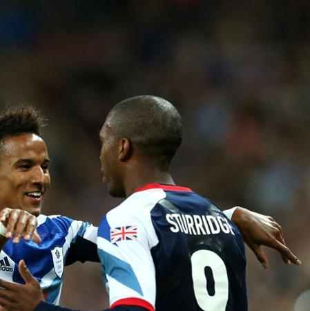 LONDON, ENGLAND - JULY 29: Scott Sinclair and Daniel Sturridge of Great Britain celebrate after scoring a goal during the Men's Football first round Group A Match between Great Britain and United Arab Emirates on Day 2 of the London 2012 Olympic Games at Wembley Stadium on July 29, 2012 in London, England. (Photo by Julian Finney/Getty Images)