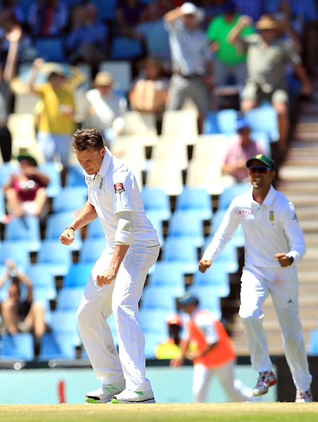 South Africa's bowler Dale Steyn celebrates dismissing Australia's captain Michael Clarke for 23 runs on the first day of their cricket test match against South Africa at Centurion Park in Pretoria, South Africa, Wednesday, Feb. 12, 2014. (AP Photo/Themba Hadebe)