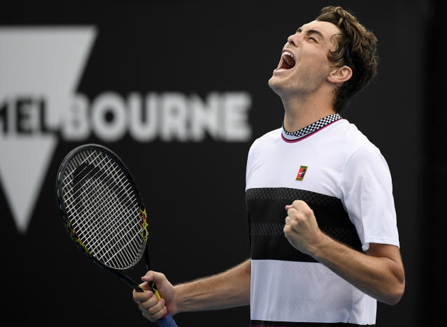 United States' Taylor Fritz celebrates after defeating France's Gael Monfils in their second round match at the Australian Open tennis championships in Melbourne, Australia, Wednesday, Jan. 16, 2019. (AP Photo/Andy Brownbill)
