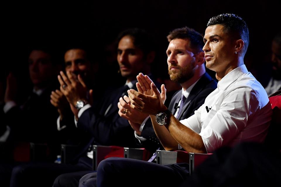 Cristiano Ronaldo (right) of Juventus and Lionel Messi of Barcelona (second from right) will meet in the group stage of the UEFA Champions League. (Valerio Pennicino/Getty Images)