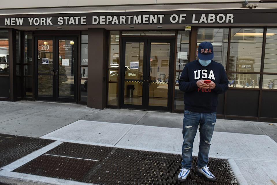 Luis Mora stands in front of the closed offices of the New York State Department of Labor on May 7, 2020 in the Brooklyn borough in New York City.