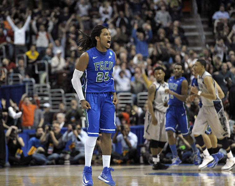 Florida Gulf Coast's Sherwood Brown reacts after a making a basket during the second half of a second-round game against Georgetown in the NCAA college basketball tournament, Friday, March 22, 2013, in Philadelphia. (AP Photo/Michael Perez)