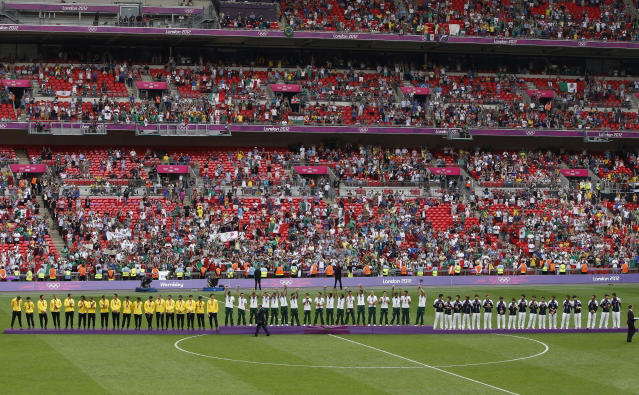 (L to R) Silver medallists Brazil, gold medallists Mexico and bronze medallists South Korea stand on the medal podiums during the soccer medal award ceremony at Wembley Stadium during the London 2012 Olympic Games August 11, 2012. REUTERS/Paul Hanna (BRITAIN - Tags: SPORT SOCCER OLYMPICS)