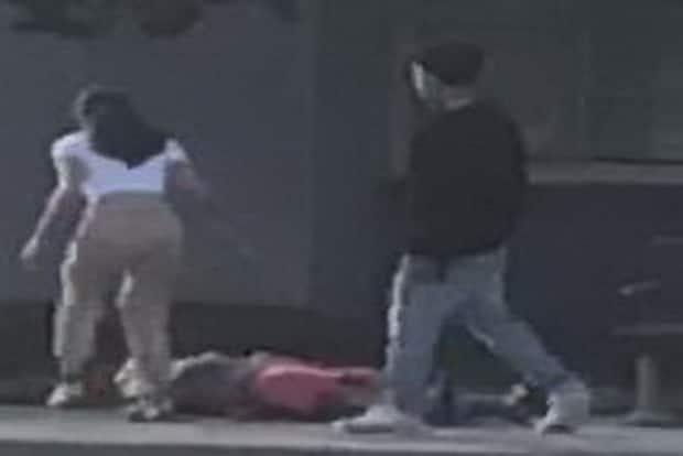 Richmond RCMP said images from video captured at the scene show someone coming to the young man's aid as the suspect walks away. (Richmond RCMP - image credit)