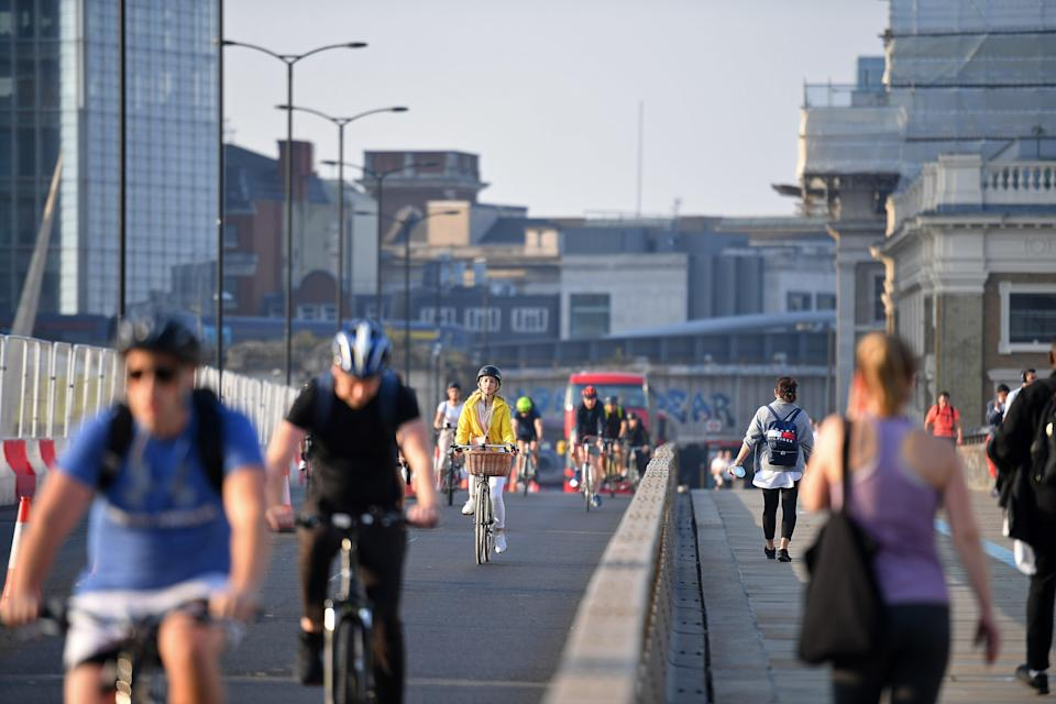 The IPPR recommends that town and city centres aim to be car-free by 2030, reallocating road space for walking and cycling (AFP via Getty Images)
