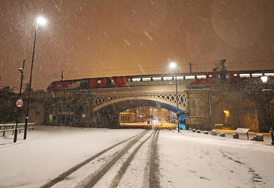 <p>Trains have faced delays and cancellations across the UK as heavy snow disrupts schedules. (PA) </p>