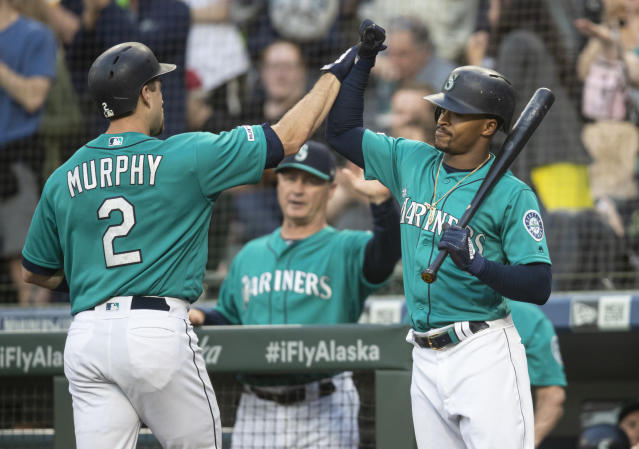 Seattle Mariners' Tom Murphy, left, is congratulated by Mallex Smith after hitting a two-run home run off of Los Angeles Angels starting pitcher Tyler Skaggs that also scored Jay Bruce during the second inning of a baseball game Friday, May 31, 2019, in Seattle. (AP Photo/Stephen Brashear)