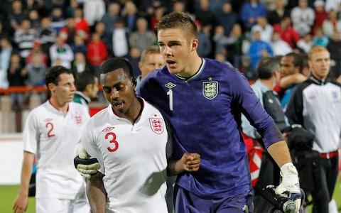 Danny Rose (L) of England is led away by team-mate Jack Butland of England after the Under 21 European Championship Play Off - Credit: Getty Images