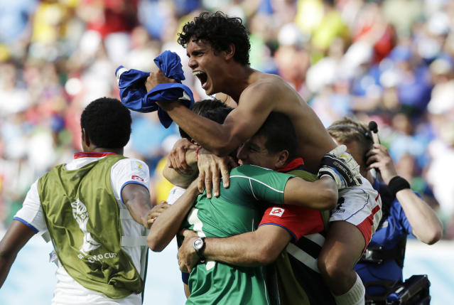 Costa Rica players celebrate with goalkeeper Keylor Navas (1) following the team's 1-0 victory over Italy during the group D World Cup soccer match between Italy and Costa Rica at the Arena Pernambuco in Recife, Brazil, Friday, June 20, 2014. (AP Photo/Ricardo Mazalan)