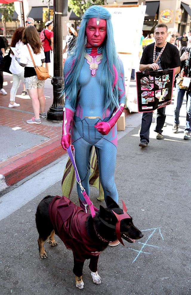 <p>Cosplayer dressed as Vision with her dog dressed as Scarlet Witch at Comic-Con International on July 20, 2018, in San Diego. (Photo: Quinn P. Smith/Getty Images) </p>