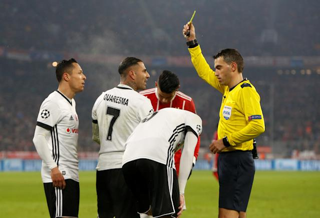 Soccer Football - Champions League Round of 16 First Leg - Bayern Munich vs Besiktas - Allianz Arena, Munich, Germany - February 20, 2018 Besiktas' Ricardo Quaresma is shown a yellow card by referee Ovidiu Hategan after a foul on Bayern Munich's Kingsley Coman (not pictured) REUTERS/Michaela Rehle