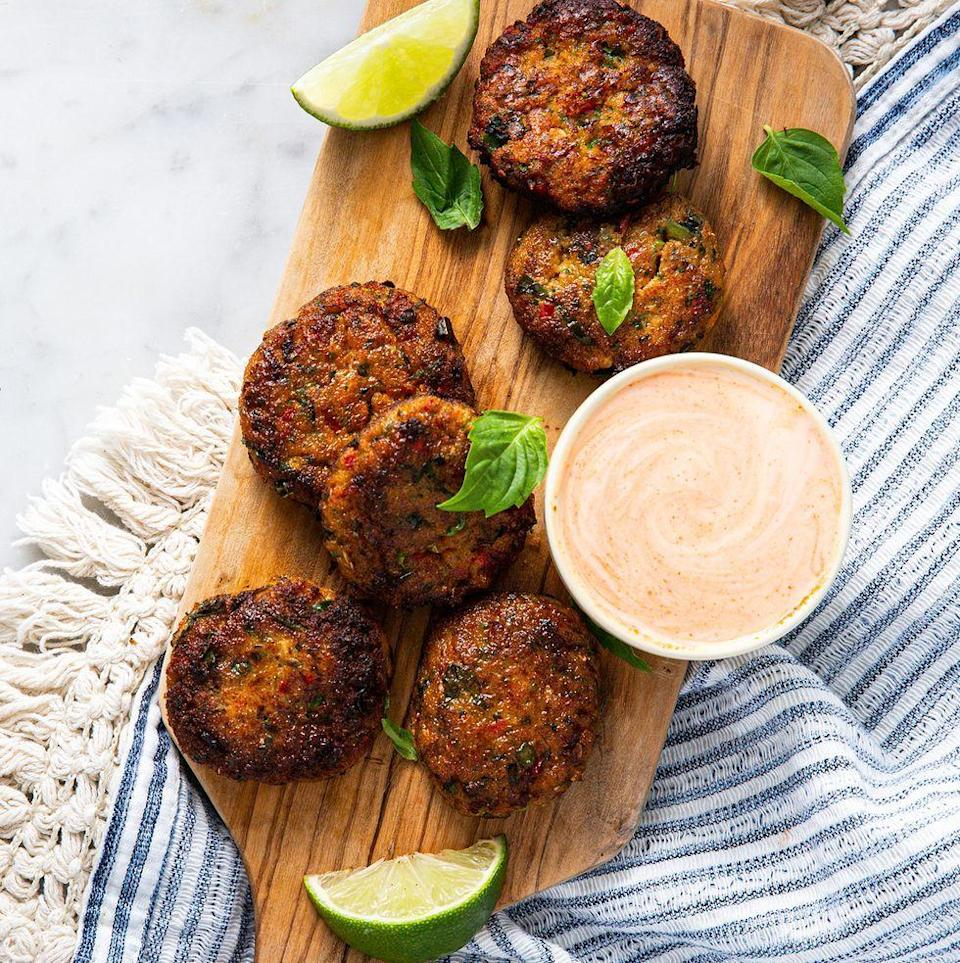 """<p>These <a href=""""https://www.delish.com/uk/cooking/recipes/g30761979/thai-food/"""" rel=""""nofollow noopener"""" target=""""_blank"""" data-ylk=""""slk:Thai"""" class=""""link rapid-noclick-resp"""">Thai</a> Fish Cakes are incredibly delicious. Seasoned beautifully and topped with <a href=""""https://www.delish.com/uk/cooking/recipes/a28756634/garlic-sriracha-pork-stir-fry-recipe/"""" rel=""""nofollow noopener"""" target=""""_blank"""" data-ylk=""""slk:sriracha"""" class=""""link rapid-noclick-resp"""">sriracha</a> mayo, you're going to want to eat these on the regular. </p><p>Get the <a href=""""https://www.delish.com/uk/cooking/recipes/a30622495/thai-fish-cakes/"""" rel=""""nofollow noopener"""" target=""""_blank"""" data-ylk=""""slk:Thai Fish Cakes"""" class=""""link rapid-noclick-resp"""">Thai Fish Cakes</a> recipe.</p>"""