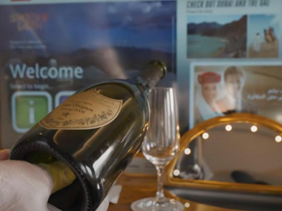Champagne? Flying first-class comes with perks (Youtube/Ben Morris)