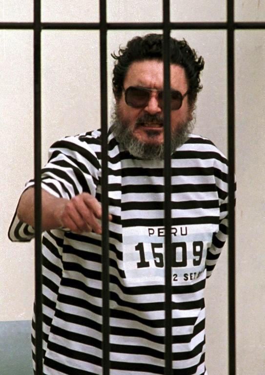 This file photo taken on September 24, 1992, shows Abimael Guzman, the captured leader of the radical group Shining Path, behind bars in Lima, Peru (AFP/HECTOR MATA)
