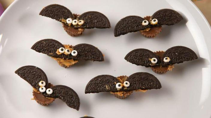 """<p>Reese's candy, Oreo cookies, peanut butter, and candy eyes come together to make this delicious treat. But hurry and eat them before they fly away!</p><p><em><strong>Get the recipe at <a href=""""https://www.delish.com/holiday-recipes/halloween/videos/a56190/reeses-bats-video/"""" rel=""""nofollow noopener"""" target=""""_blank"""" data-ylk=""""slk:Delish"""" class=""""link rapid-noclick-resp"""">Delish</a>.</strong></em></p>"""