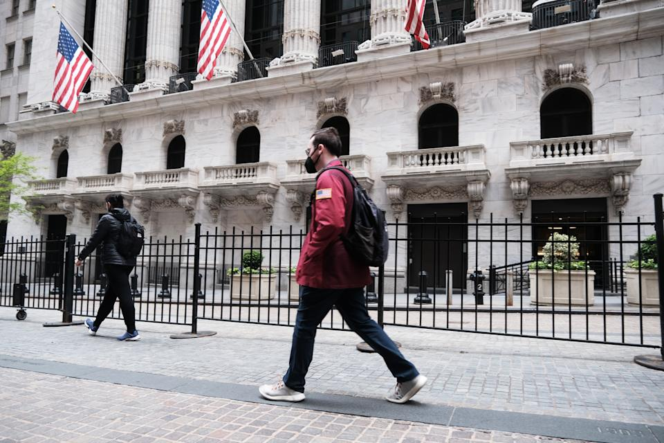 NEW YORK, NEW YORK - MAY 11: People walk by the New York Stock Exchange after global stocks fell as concerns mount that rising inflation will prompt central banks to tighten monetary policy on May 11, 2021 in New York City. By mid afternoon the tech-heavy Nasdaq Composite had lost 0.6% after falling 2.2% at its session low.  (Photo by Spencer Platt/Getty Images)