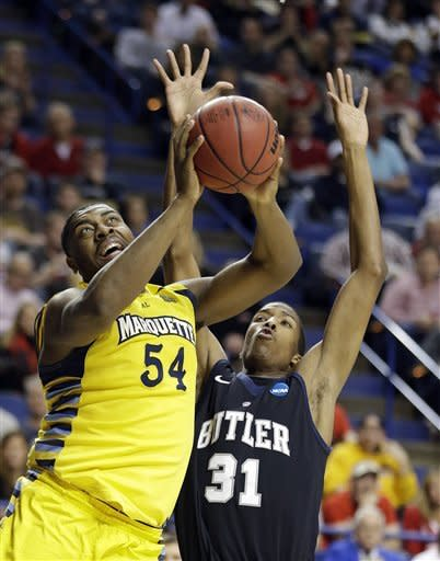 Marquette forward Davante Gardner (54) shoots as Butler forward Kameron Woods (31) defends in the first half of a third-round NCAA college basketball tournament game on Saturday, March 23, 2013, in Lexington, Ky. (AP Photo/John Bazemore)