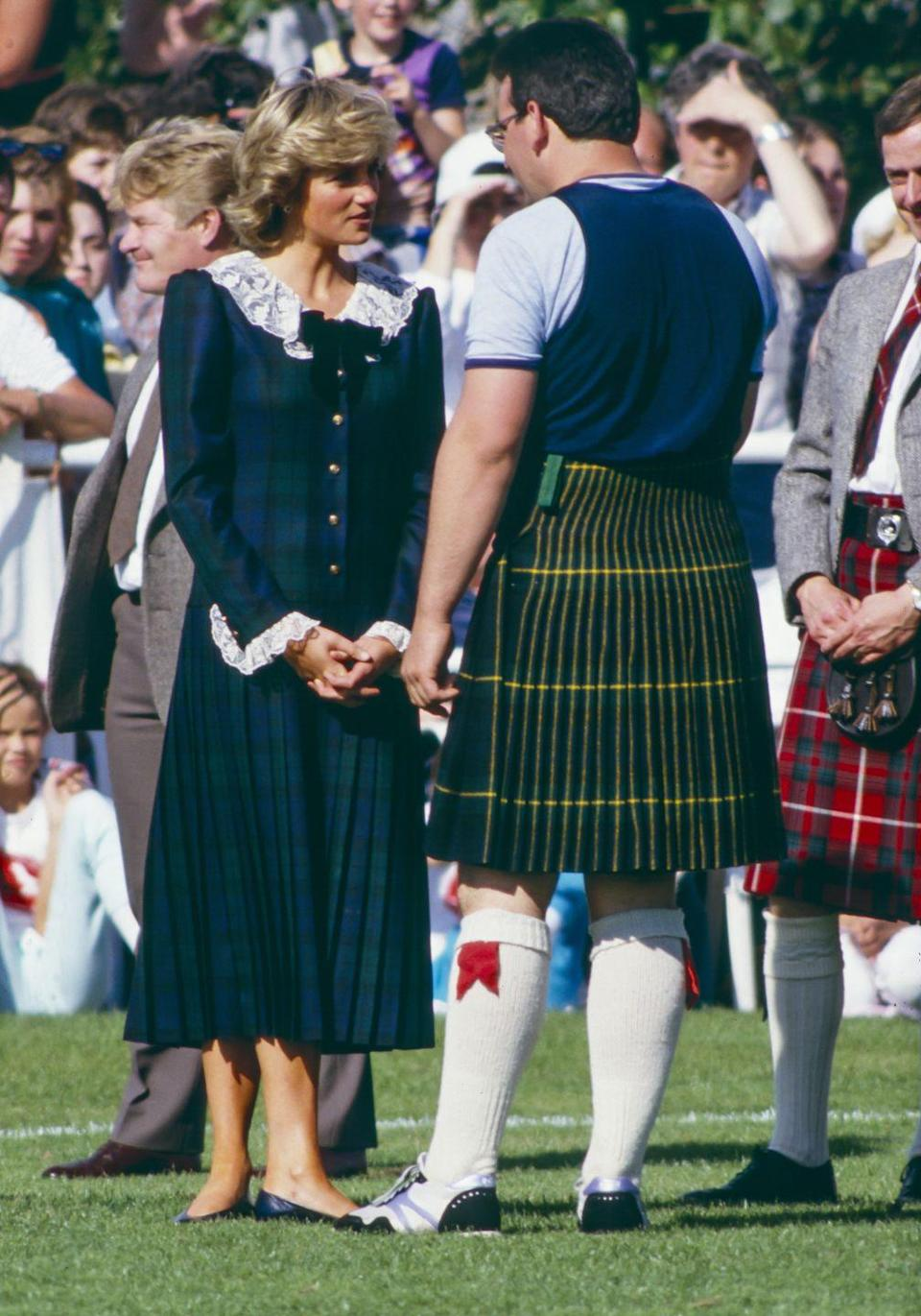 <p>The Princess attends The Bute Highland Games on August 22, 1987, wearing a green tartan dress with a white lace pilgrim collar and lace cuffs.</p>