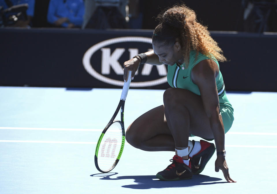 United States' Serena Williams rests on the court during her third round match against Ukraine's Dayana Yastremska at the Australian Open tennis championships in Melbourne, Australia, Saturday, Jan. 19, 2019. (AP Photo/Andy Brownbill)