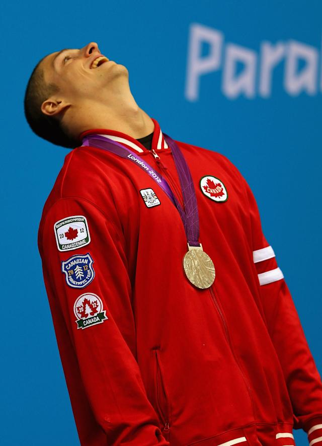 LONDON, ENGLAND - AUGUST 31: Nathan Stein of Canada celebrates winning the gold medal in the Men's 50m Freestyle - S10 on day 2 of the London 2012 Paralympic Games at Aquatics Centre on August 31, 2012 in London, England. (Photo by Mike Ehrmann/Getty Images)