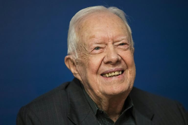 Former US President Jimmy Carter, pictured in March 2018, left a Georgia hospital Wednesday after treatment for a urinary tract infection (AFP Photo/Drew Angerer)