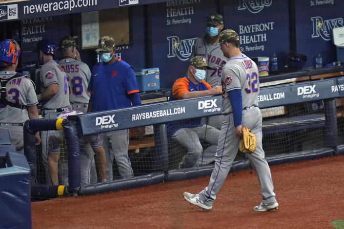 New York Mets relief pitcher Aaron Loup (32) walks off the field after giving up a walk-off RBI single of Tampa Bay Rays' Brett Phillips during the ninth inning of a baseball game Friday, May 14, 2021, in St. Petersburg, Fla. (AP Photo/Chris O'Meara)