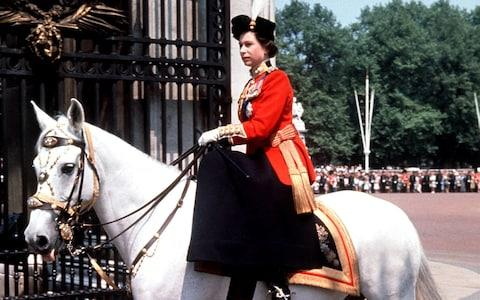 Queen Elizabeth II riding side-saddle as she returns to Buckingham Palace, London, after attending the Trooping the Colour ceremony on Horse Guards Parade in 1963 - Credit: PA