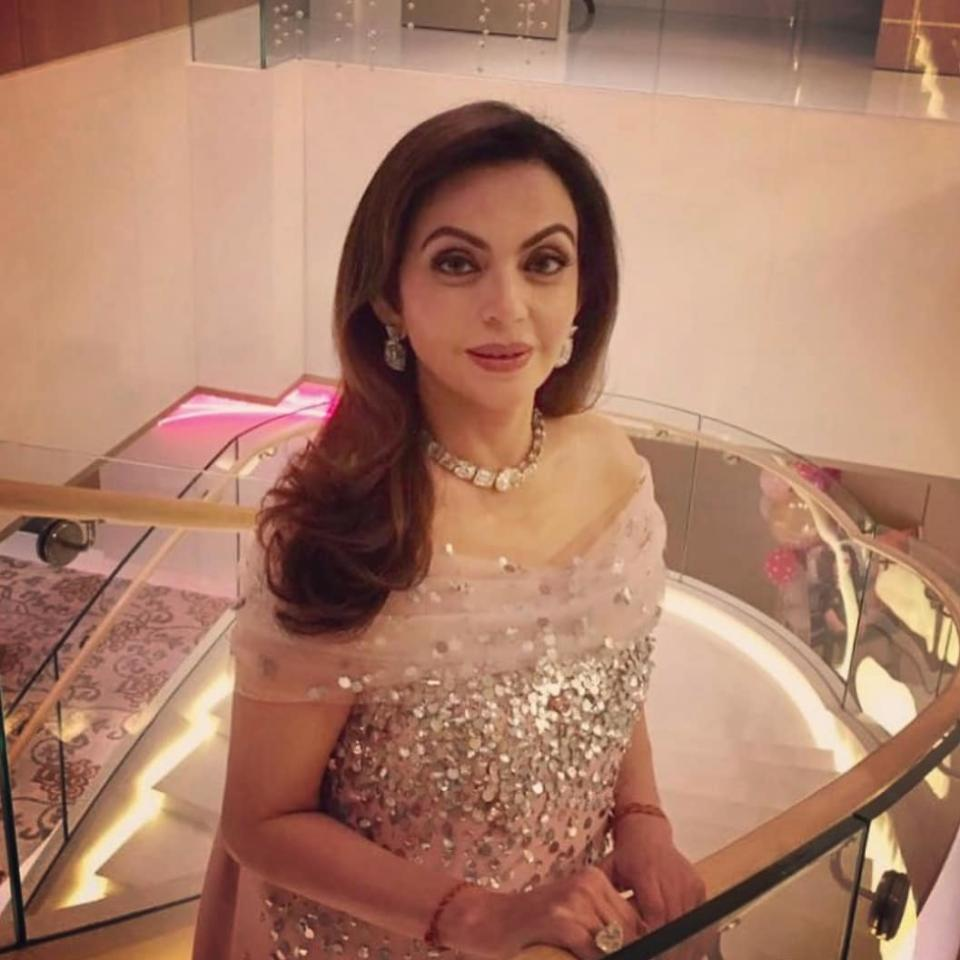 <p>From a college student to India's richest businessman's better-half – hers is a story straight out of a fairy tale book. Sitting atop 44.3 billion US dollar, Neeta Ambani's independent worth is $980 million dollars. A generous philanthropist, she is the founder of Reliance Foundation and enjoys quite an opulent lifestyle also. Mercedes Benz, BMW, Jaguar, Mini Cooper, Rolls Royce – you name the road beast and she owns it. Her jewelry collection can keep the city illuminated, the best labels feel honored to dress her. We wonder how many rounds of the planet she has taken yet. Oh… did we tell you that she is the queen of the most expensive home in the whole world? </p>