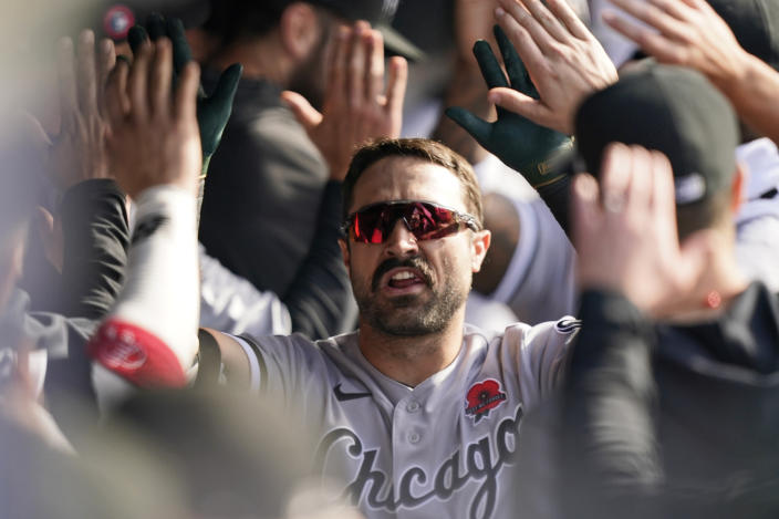Chicago White Sox's Adam Eaton is congratulated after hitting a two-run home run in the eighth inning of the first baseball game of a doubleheader against the Cleveland Indians, Monday, May 31, 2021, in Cleveland. (AP Photo/Tony Dejak)