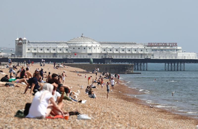There are fears that crowded beaches could lead to a spike in cases. (Photo: PA)
