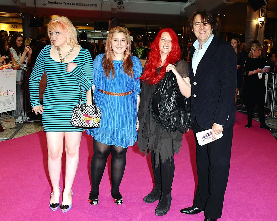 Jonathan Ross and wife Jane Goldman and their children Betty Kitten (left) and Honey Kinney (second left) arriving for the premiere of One Day at the Vue Cinema, Westfield Shopping Centre, White City.