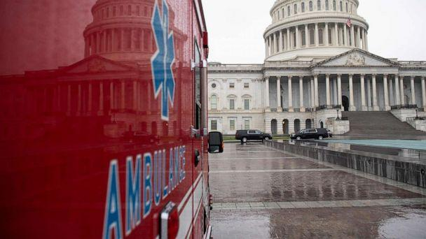 PHOTO: An ambulance sits outside the U.S. Capitol in Washington, D.C., on March 23, 2020, as the Senate continues negotiations on an economic relief package in response to the coronavirus pandemic. (Saul Loeb/AFP via Getty Images)