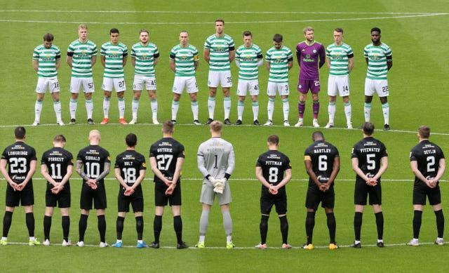 Celtic and Livingston players stand for a minute's silence