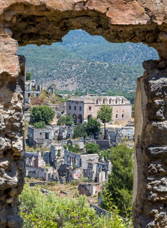"""<p>This town nestled in the Taurus Mountains was deserted in the 1920s because of a political <a href=""""http://www.atlasobscura.com/places/kayakoy-turkey"""" rel=""""nofollow noopener"""" target=""""_blank"""" data-ylk=""""slk:population exchange with Greece"""" class=""""link rapid-noclick-resp"""">population exchange with Greece</a>. Today, there are around 350 abandoned homes in the city. </p>"""