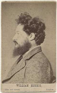 Black and white profile photo of William Morris with dark hair and beard.