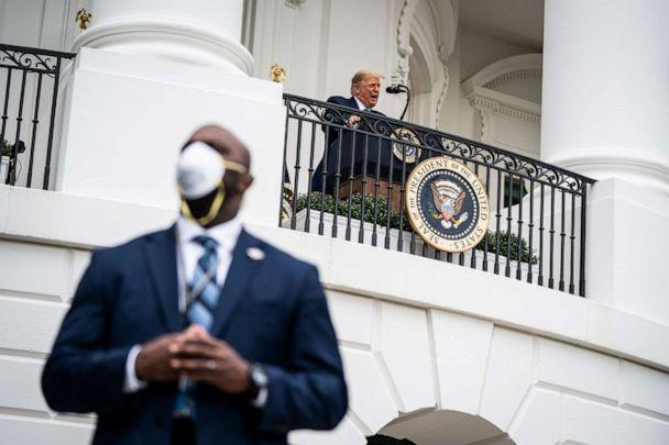 PHOTO: A member of the United States Secret Service wears a face mask while standing guard as President Donald Trump speaks to supporters from the Blue Room balcony during an event at the White House, Oct. 10, 2020, in Washington. (The Washington Post via Getty Images, FILE)