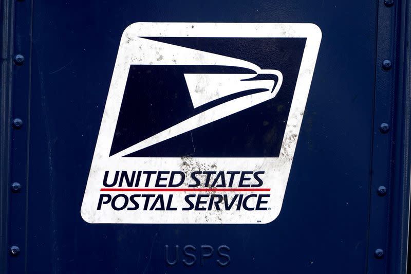A U.S. Postal Service (USPS) logo is pictured on a mail box
