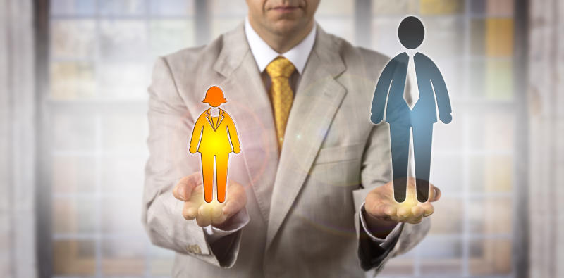 Unrecognizable recruiter comparing a small energetic female worker icon with a big male employee symbol. Photo: Getty