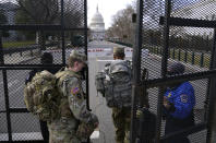 With the U.S. Capitol in the background, troops are let through a security gate on Saturday, Jan. 16, 2021, in Washington as security is increased ahead of the inauguration of President-elect Joe Biden and Vice President-elect Kamala Harris. (AP Photo/John Minchillo)