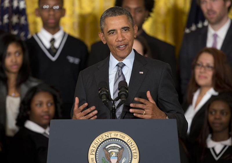 President Barack Obama speaks about his Promise Zones Initiative, Thursday, Jan. 9, 2014, in the East Room of the White House in Washington. Also on stage are representatives and community members from each of the five Zones. The Promise Zone Initiative is part of a plan to create a better bargain for the middle-class by partnering with local communities and businesses to create jobs, increase economic security, expand educational opportunities, increase access to quality, affordable housing and improve public safety. (AP Photo/Carolyn Kaster
