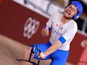 <p>Italy's Simone Consonni celebrates after winning gold and setting a new World Record in the men's track cycling team pursuit finals during the Tokyo 2020 Olympic Games at Izu Velodrome in Izu, Japan, on August 4, 2021. (Photo by Odd ANDERSEN / AFP) (Photo by ODD ANDERSEN/AFP via Getty Images)</p>