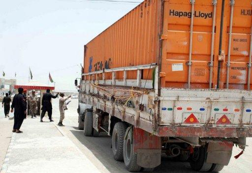 Pakistani soldiers check the documents of a first container truck carrying NATO supplies