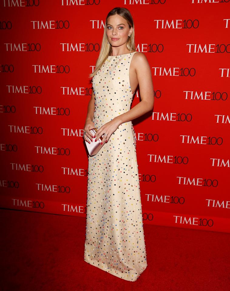 <p>Margot proved the powers of a simple dress, choosing a nude embellished Prada gown. (Photo: Reuters) </p>
