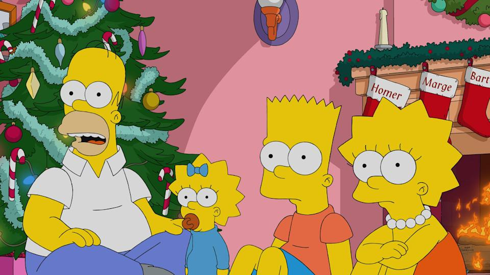 Homer, left, Maggie, Bart and Lisa Simpson learn new things in the 700th episode of