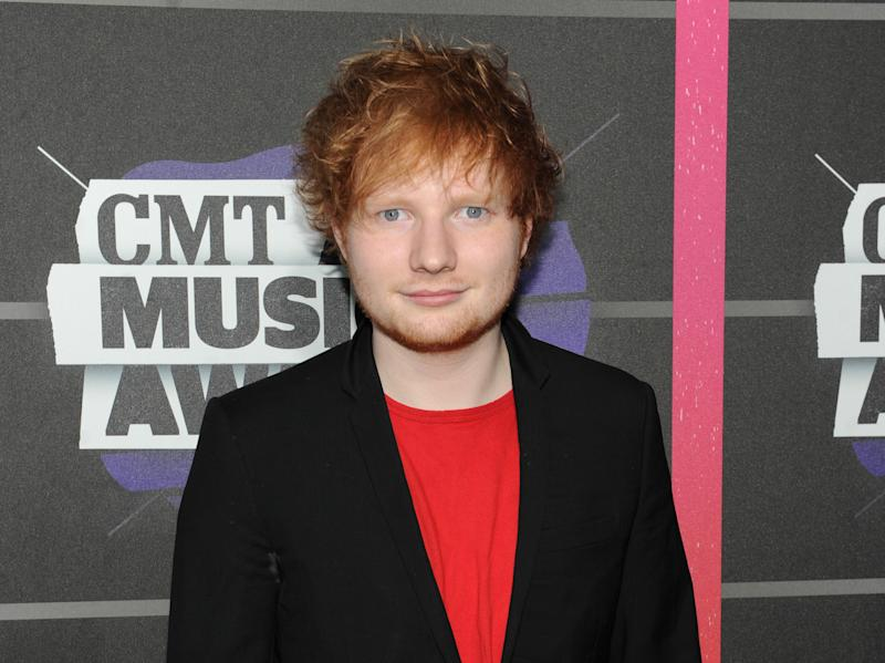 "FILE - This June 5, 2013 file photo shows British singer-songwriter Ed Sheeran at the 2013 CMT Music Awards at Bridgestone Arena in Nashville, Tenn. Sheeran moved to Nashville in February, settling just outside of town in a rural area. ""I wanted to live somewhere that like incorporated a lot of music, was relaxed, had a lot of countryside, but also wasn't filled with dicks,"" Sheeran said. ""And Nashville is full of very, very nice people."" (Photo by Frank Micelotta/Invision/AP, file)"