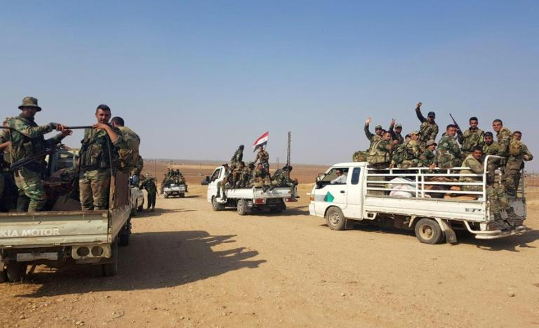 A Syrian army convoy on a road between the cities of Tal Tamr and Ras al-Ain in Hassakeh province of northeast Syria on the border with Turkey