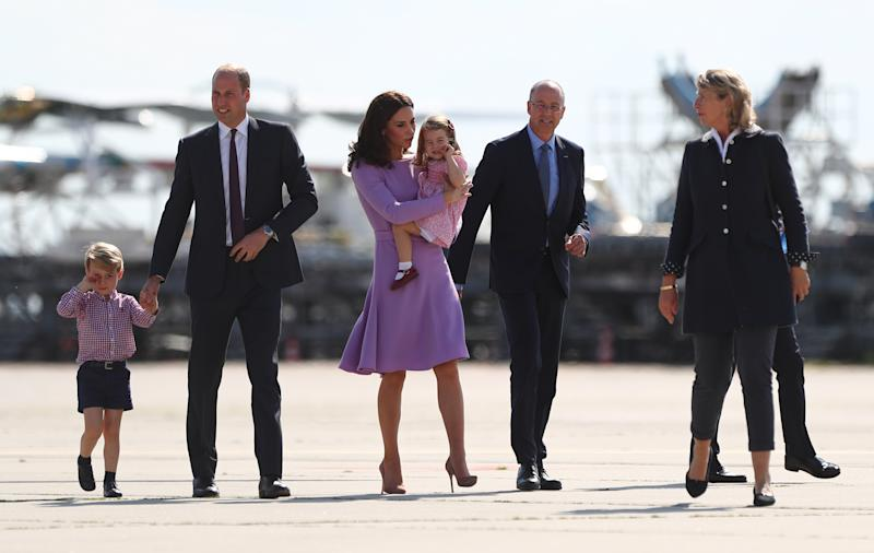 Great Britain's Prince William and Duchess Kate look at an Airbus helicopter with their children George and Charlotte, guided by the CEO of Airbus, Wolfgang Schoder (2-R) in Hamburg, Germany, 21 July 2017. Hamburg is the last leg of the royal couple's Germany visit. Photo: Christian Charisius/dpa (Photo by Christian Charisius/picture alliance via Getty Images)